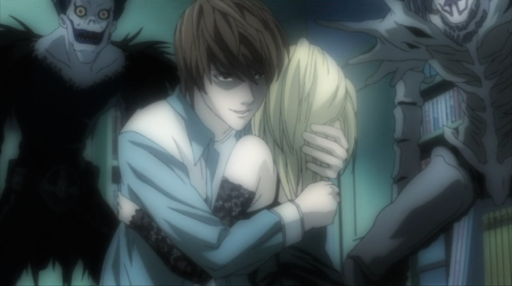 Light embraces Misa while the shinigami look on. (ep 13)
